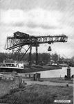 64058 Gezicht op de overslagkraan voor kolen voor de electrische centrale van de PEGUS aan de industriehaven bij het ...