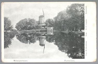 WAT001012848 Meelmolen 'De Noord' met een aantal huisjes die deels in het water stonden. De molen is op 12 september ...