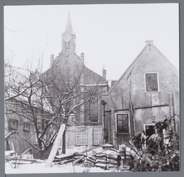 WAT001003033 Sloop van de gebouwen van het secretariaat Beemsterpolder.Op de achtergrond de Lutherse Kerk, gebouwd in ...