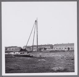 WAT001003536 Eerste paal geslagen voor de nieuw te bouwen ULO school de latere Wherelant Mavo.