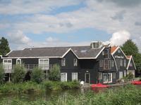 WAT120003287 Hotel 'De Purmer Eend' ruim honderd jaar geleden was dit een graanmaalderij.