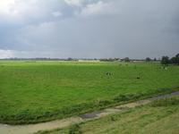 WAT120003310 Foto gemaakt vanaf de Purmerdijk.Links uit beeld loopt de Blijweg (later overgaand in de Westerweg)