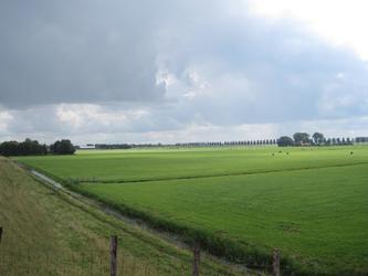 WAT120003312 Foto gemaakt vanaf de Purmerdijk.Rechts uit beeld loopt de Blijweg (later overgaand in de Westerweg)