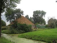 WAT120003500 Stolpboerderij aan de Oosterweg nummer M 8.