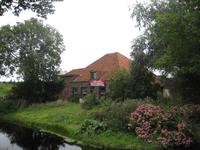 WAT120003500 Stolpboerderij aan de Oosterweg nummer M 11.