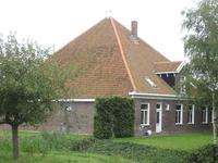 WAT120003584 Stolpboerderij aan de Oosterweg nummer E 22.