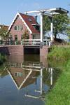 WAT120002522 De huidige Oost-Knollendammersluis, ook wel Boerensluis genoemd, werd gebouwd in 1789. Door het verdwijnen ...
