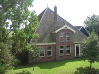WAT120003290 Stolpboerderij aan de Purmerdijk nummer 11.