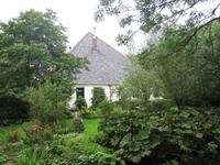 WAT120003423 Stolpboerderij (Groenewoud) met een deel tuin aan de Westerweg 21