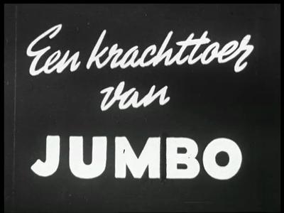 12825 BB02518 Een reclamefilm voor Jumbo-overalls, waarin een garagemonteur op weg naar een klant met pech bemerkt dat ...