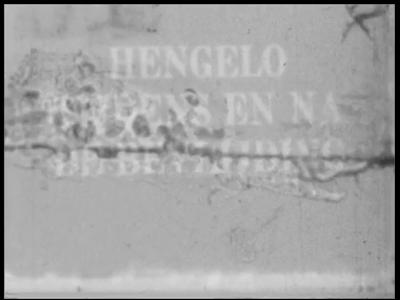8964 BB06740 Samenvatting:Tweede deel van een amateurfilm met beelden van gebeurtenissen in Hengelo tijdens en na de ...