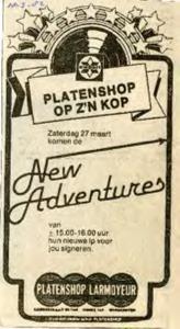 Platenshop Larmoyeur : advertentie signeren door New Adventures van hun nieuwe elpee